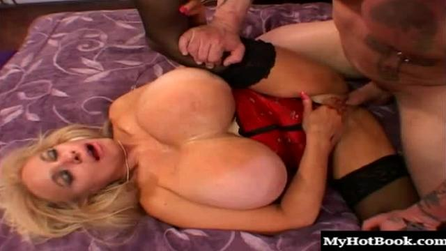 Echo Valley is a mature blonde with massive boobs.  They bounce up